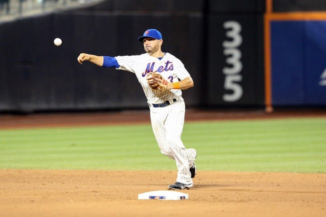 Jul 23, 2013; New York, NY, USA;  New York Mets shortstop Omar Quintanilla (3) throws to first for the final out against the Atlanta Braves at Citi Field.  Mets won 4-1.  Mandatory Credit: Anthony Gruppuso-USA TODAY Sports