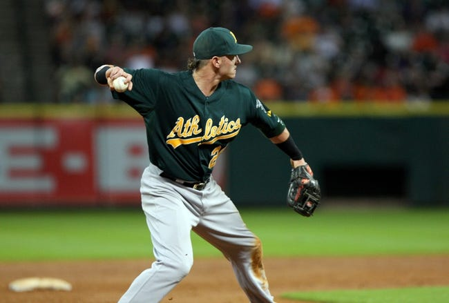 Jul 23, 2013; Houston, TX, USA; Oakland Athletics third baseman Josh Donaldson (20) throws to first base during the third inning against the Houston Astros at Minute Maid Park. Mandatory Credit: Troy Taormina-USA TODAY Sports