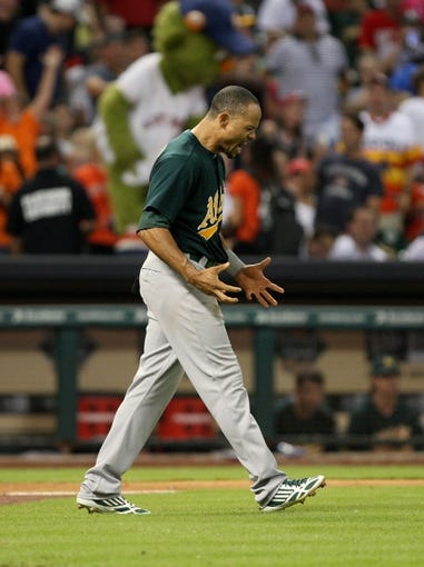 Jul 23, 2013; Houston, TX, USA; Oakland Athletics center fielder Coco Crisp (4) reacts after striking out during the seventh inning Houston Astros at Minute Maid Park. Mandatory Credit: Troy Taormina-USA TODAY Sports