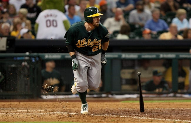 Jul 23, 2013; Houston, TX, USA; Oakland Athletics second baseman Eric Sogard (28) hits a double during the seventh inning against the Houston Astros at Minute Maid Park. Mandatory Credit: Troy Taormina-USA TODAY Sports