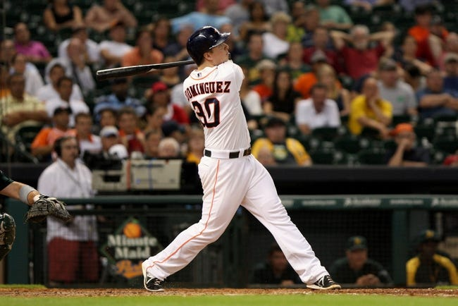 Jul 23, 2013; Houston, TX, USA; Houston Astros third baseman Matt Dominguez (30) hits a home run during the ninth inning against the Oakland Athletics at Minute Maid Park. Mandatory Credit: Troy Taormina-USA TODAY Sports