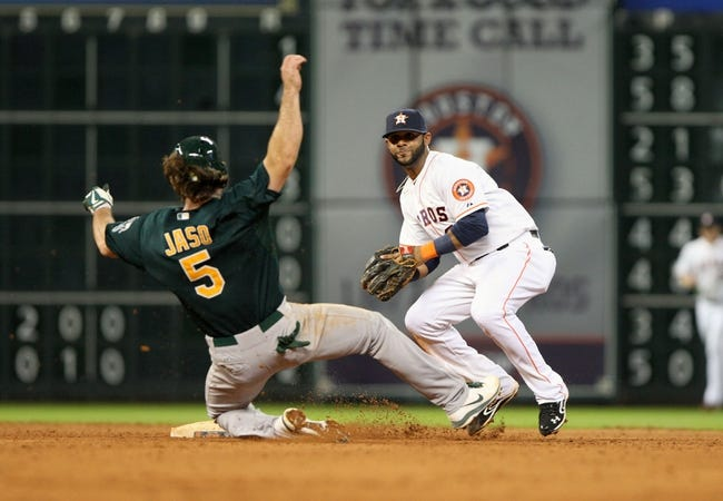 Jul 23, 2013; Houston, TX, USA; Oakland Athletics catcher John Jaso (5) is out as Houston Astros shortstop Jonathan Villar (6) throws to first base to complete a double play during the eighth inning at Minute Maid Park. Mandatory Credit: Troy Taormina-USA TODAY Sports
