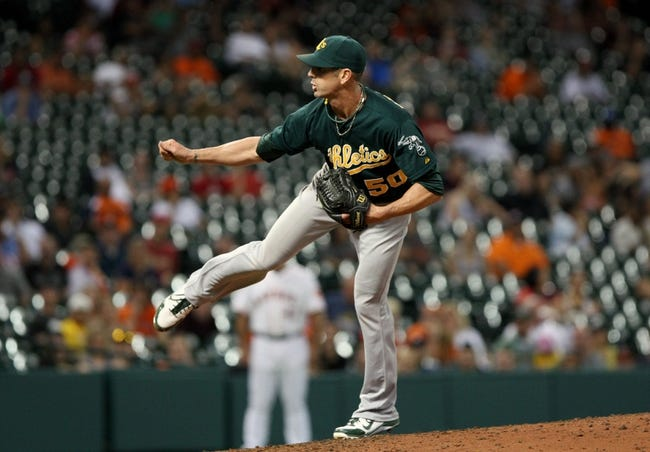 Jul 23, 2013; Houston, TX, USA; Oakland Athletics relief pitcher Grant Balfour (50) pitches during the ninth inning against the Houston Astros at Minute Maid Park. Mandatory Credit: Troy Taormina-USA TODAY Sports