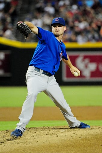 Jul 23, 2013; Phoenix, AZ, USA; Chicago Cubs starting pitcher Travis Wood (37) throws during the first inning against the Arizona Diamondbacks at Chase Field. Mandatory Credit: Matt Kartozian-USA TODAY Sports