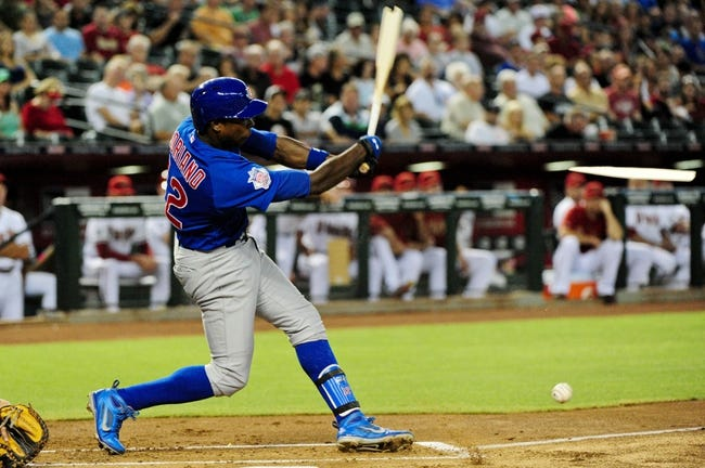 Jul 23, 2013; Phoenix, AZ, USA; Chicago Cubs left fielder Alfonso Soriano (12) breaks his bat during the first inning against the Arizona Diamondbacks at Chase Field. Mandatory Credit: Matt Kartozian-USA TODAY Sports