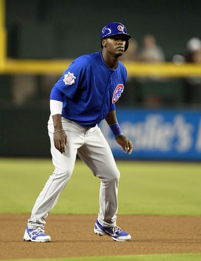 Jul 24, 2013; Phoenix, AZ, USA; Chicago Cubs center fielder Junior Lake (21) leads off second base in the first inning during a baseball game against the Arizona Diamondbacks at Chase Field. Mandatory Credit: Rick Scuteri-USA TODAY Sports