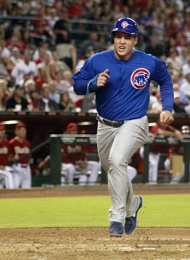 Jul 24, 2013; Phoenix, AZ, USA;  Chicago Cubs first baseman Anthony Rizzo (44) scores in the fourth inning during a baseball game against the Arizona Diamondbacks at Chase Field. Mandatory Credit: Rick Scuteri-USA TODAY Sports