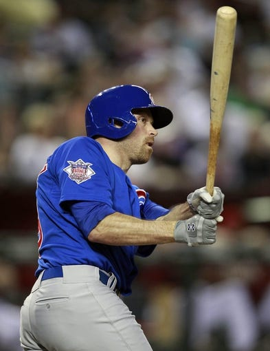 Jul 24, 2013; Phoenix, AZ, USA; Chicago Cubs right fielder Nate Schierholtz (19) hits a three run home run against the Arizona Diamondbacks in the fifth inning during a baseball game at Chase Field. Mandatory Credit: Rick Scuteri-USA TODAY Sports