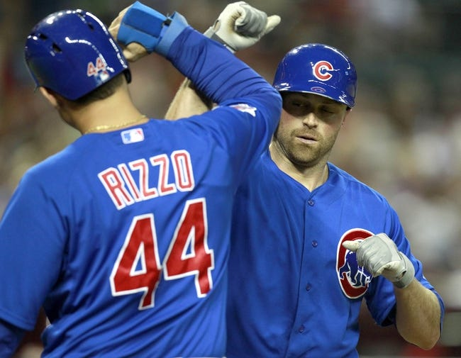 Jul 24, 2013; Phoenix, AZ, USA; Chicago Cubs right fielder Nate Schierholtz (19) celebrates with Anthony Rizzo (44) after hitting a three run home run against the Arizona Diamondbacks in the fifth inning during a baseball game at Chase Field. Mandatory Credit: Rick Scuteri-USA TODAY Sports