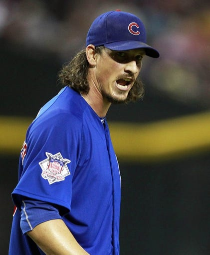 Jul 24, 2013; Phoenix, AZ, USA; Chicago Cubs starting pitcher Jeff Samardzija (29) reacts after an error resulted in him allowing two runs in the fifth inning during a baseball game against the Arizona Diamondbacks at Chase Field. Mandatory Credit: Rick Scuteri-USA TODAY Sports