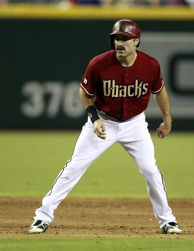Jul 24, 2013; Phoenix, AZ, USA; Arizona Diamondbacks left fielder Adam Eaton (6) leads off second base against the Chicago Cubs in the fifth inning during a baseball game at Chase Field. Mandatory Credit: Rick Scuteri-USA TODAY Sports
