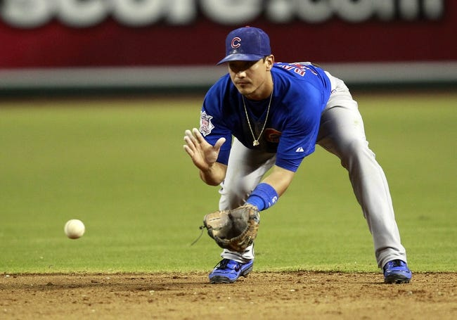 Jul 24, 2013; Phoenix, AZ, USA; Chicago Cubs second baseman Darwin Barney (15) fields a ground ball against the Arizona Diamondbacks in the fifth inning during a baseball game at Chase Field. Mandatory Credit: Rick Scuteri-USA TODAY Sports