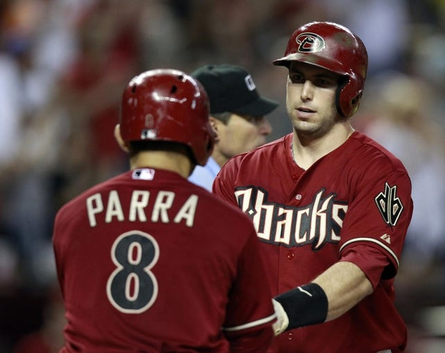 Jul 24, 2013; Phoenix, AZ, USA; Arizona Diamondbacks first baseman Paul Goldschmidt (44) celebrates with Gerardo Parra (8) after hitting a three run home run against the Chicago Cubs in the fifth inning during a baseball game at Chase Field. Mandatory Credit: Rick Scuteri-USA TODAY Sports