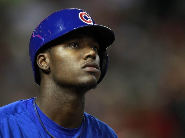 Jul 24, 2013; Phoenix, AZ, USA; Chicago Cubs center fielder Junior Lake (21) in the tenth inning during a baseball game against the Arizona Diamondbacks at Chase Field. Mandatory Credit: Rick Scuteri-USA TODAY Sports