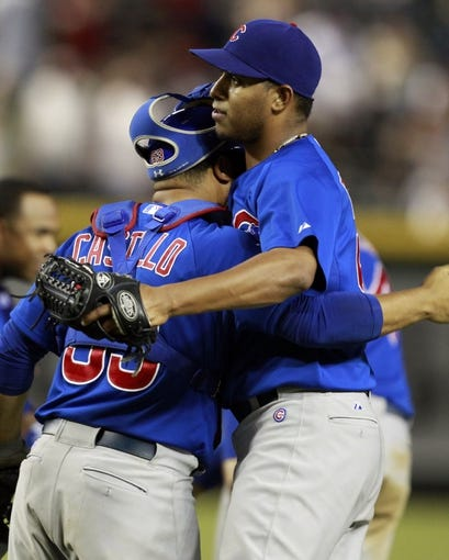 Jul 24, 2013; Phoenix, AZ, USA; Chicago Cubs catcher Welington Castillo (53) and Hector Rondon (56) celebrate after defeating the Arizona Diamondbacks 7-6 in twelve innings at Chase Field. Mandatory Credit: Rick Scuteri-USA TODAY Sports