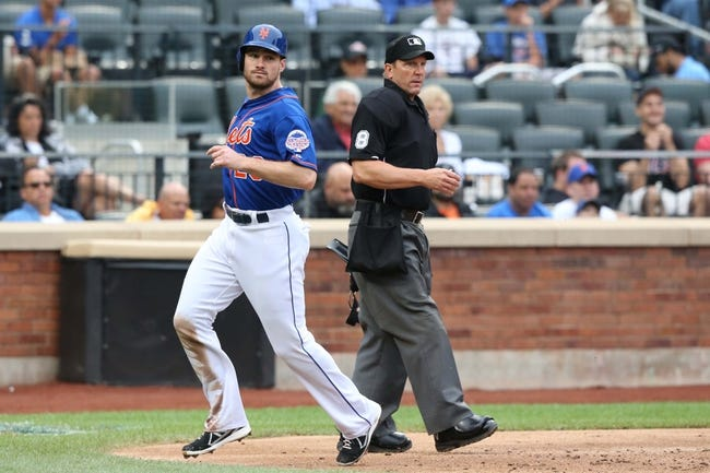 Jul 25, 2013; New York, NY, USA;   New York Mets second baseman Daniel Murphy (28) crosses the plate to score during the third inning against the Atlanta Braves at Citi Field. Mandatory Credit: Anthony Gruppuso-USA TODAY Sports