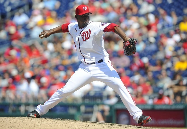 Jul 25, 2013; Washington, DC, USA; Washington Nationals relief pitcher Rafael Soriano (29) throws during the ninth inning against the Pittsburgh Pirates at Nationals Park. Mandatory Credit: Brad Mills-USA TODAY Sports