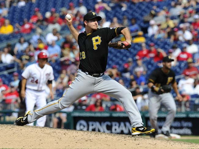 Jul 25, 2013; Washington, DC, USA; Pittsburgh Pirates relief pitcher Bryan Morris (29) throws during the ninth inning against the Washington Nationals at Nationals Park. Mandatory Credit: Brad Mills-USA TODAY Sports