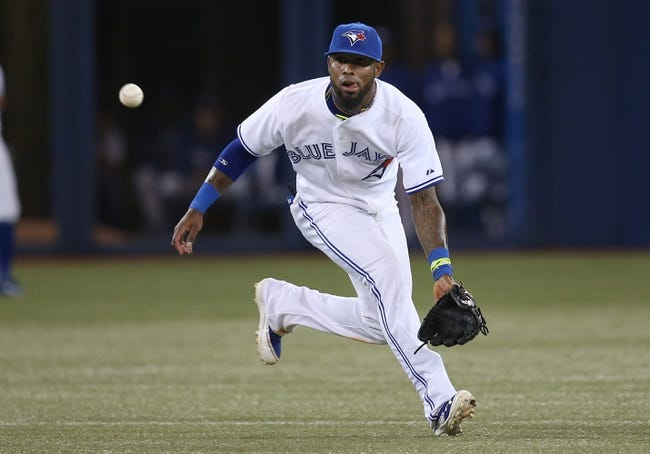 Jul 25, 2013; Toronto, Ontario, CAN; Toronto Blue Jays shortstop Jose Reyes (7) fields a grounder and throws out the baserunner in the ninth inning against the Houston Astros at Rogers Centre. The Blue Jays beat the Astros 4-0. Mandatory Credit: Tom Szczerbowski-USA TODAY Sports
