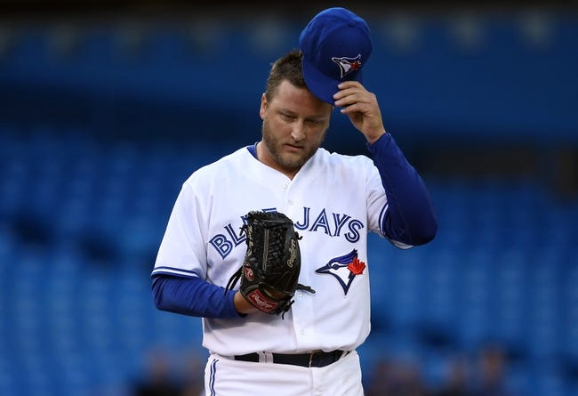 Jul 25, 2013; Toronto, Ontario, CAN; Toronto Blue Jays starting pitcher Mark Buehrle (56) during their game against the Houston Astros at Rogers Centre. The Blue Jays beat the Astros 4-0. Mandatory Credit: Tom Szczerbowski-USA TODAY Sports
