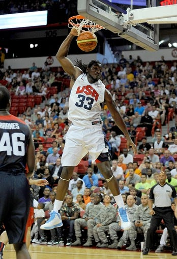 Jul 25, 2013; Las Vegas, NV, USA; USA Team White forward Kenneth Faried dunks the ball with one hand against USA Team Blue during the 2013 USA Basketball Showcase at the Thomas and Mack Center. Mandatory Credit: Stephen R. Sylvanie-USA TODAY Sports