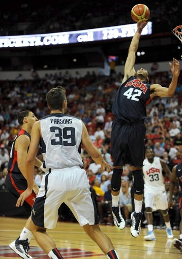 Jul 25, 2013; Las Vegas, NV, USA; USA Blue Team center Anthony Davis lunges to steal a shot attempt out of the air from USA White Team forward Chandler Parsons during the 2013 USA Basketball Showcase at the Thomas and Mack Center. Mandatory Credit: Stephen R. Sylvanie-USA TODAY Sports