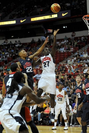 Jul 25, 2013; Las Vegas, NV, USA; USA White guard Jrue Holiday (27) attempts a shot while being defended by USA Blue guard Damian Lillard (22)  during the 2013 USA Basketball Showcase at the Thomas and Mack Center. Mandatory Credit: Stephen R. Sylvanie-USA TODAY Sports