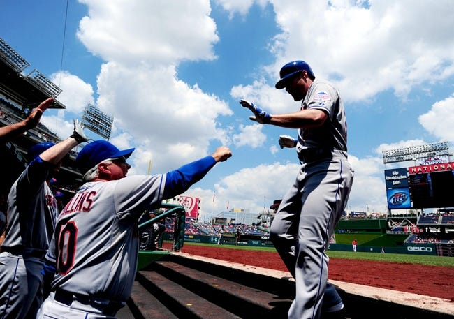 Jul 26, 2013; Washington, DC, USA; New York Mets second baseman Daniel Murphy (right) is congratulated by manager Terry Collins (left) after hitting a home run in the first inning against the Washington Nationals at Nationals Park. Mandatory Credit: Evan Habeeb-USA TODAY Sports