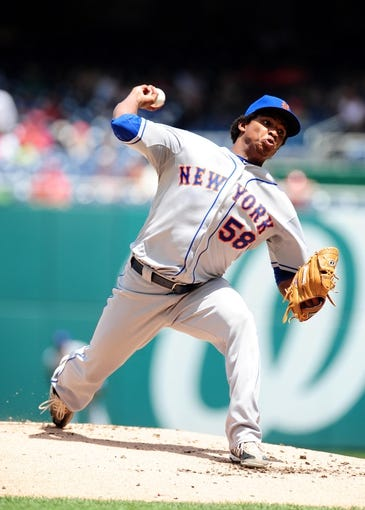 Jul 26, 2013; Washington, DC, USA; New York Mets pitcher Jenrry Mejia (58) throws a pitch in the first inning against the Washington Nationals at Nationals Park. Mandatory Credit: Evan Habeeb-USA TODAY Sports