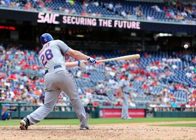 Jul 26, 2013; Washington, DC, USA; New York Mets second baseman Daniel Murphy (28) hits an RBI single in the ninth inning against the Washington Nationals at Nationals Park. Mandatory Credit: Evan Habeeb-USA TODAY Sports