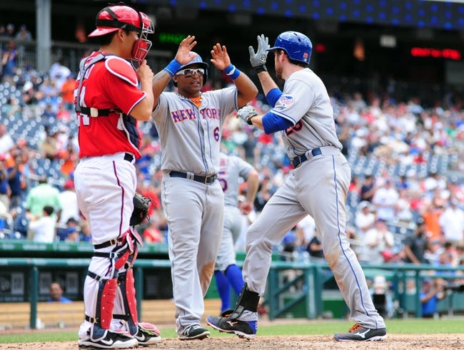 Jul 26, 2013; Washington, DC, USA; New York Mets first baseman Ike Davis (right) is congratulated by outfielder Marlon Byrd (center) after hitting a home run in the ninth inning against the Washington Nationals at Nationals Park. Mandatory Credit: Evan Habeeb-USA TODAY Sports