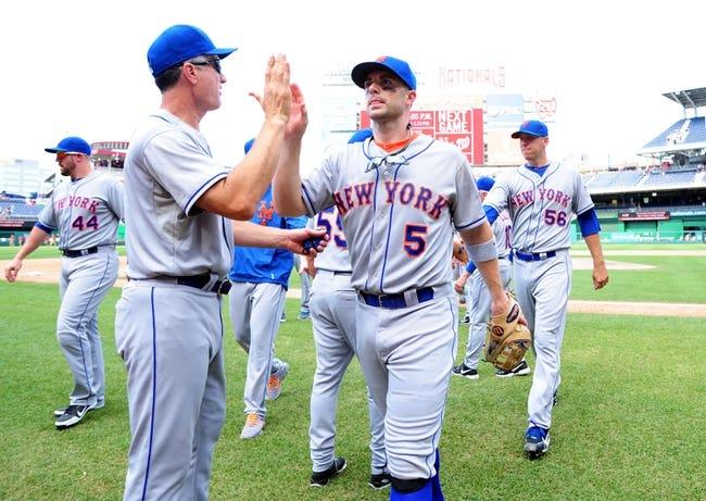 Jul 26, 2013; Washington, DC, USA; New York Mets third baseman David Wright (5) high fives teammates after beating the Washington Nationals 11-0 at Nationals Park. Mandatory Credit: Evan Habeeb-USA TODAY Sports