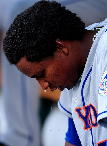 Jul 26, 2013; Washington, DC, USA; New York Mets pitcher Jenrry Mejia (58) cools off by pouring water on his head during the game against the Washington Nationals at Nationals Park. Mandatory Credit: Evan Habeeb-USA TODAY Sports
