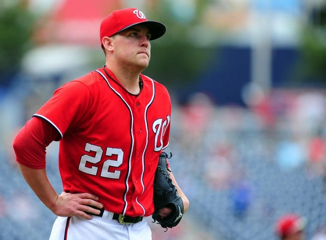 Jul 26, 2013; Washington, DC, USA; Washington Nationals pitcher Drew Storen (22) reacts after giving up a home run to New York Mets first baseman Ike Davis (not pictured) in the ninth inning at Nationals Park. Mandatory Credit: Evan Habeeb-USA TODAY Sports