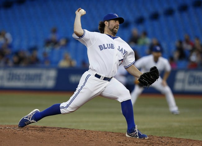 Jul 26, 2013; Toronto, Ontario, CAN; Toronto Blue Jays starting pitcher R.A. Dickey (43) throws against the Houston Astros at the Rogers Centre. Mandatory Credit: John E. Sokolowski-USA TODAY Sports