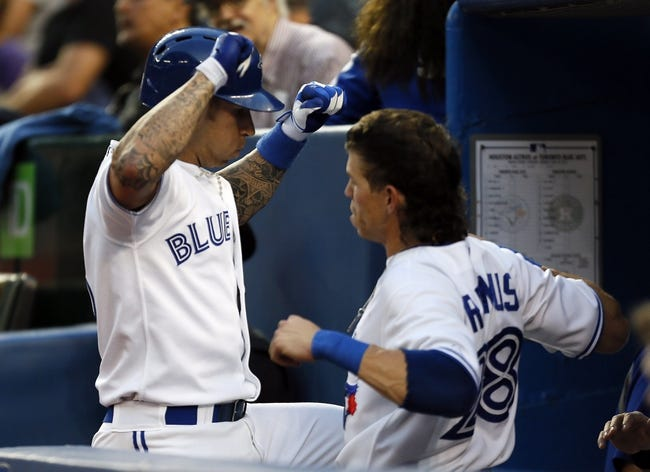 Jul 26, 2013; Toronto, Ontario, CAN; Toronto Blue Jays third baseman Brett Lawrie (13) celebrates his solo home with center fielder Colby Rasmus (28) in the fourth inning against the Houston Astros  at the Rogers Centre. Mandatory Credit: John E. Sokolowski-USA TODAY Sports