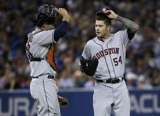 Jul 26, 2013; Toronto, Ontario, CAN; Houston Astros catcher Jason Castro (15) goes to the mound to talk to pitcher Travis Blackley (54) during the sixth inning at the Rogers Centre. Mandatory Credit: John E. Sokolowski-USA TODAY Sports
