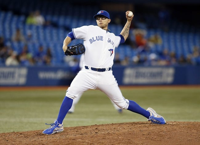 Jul 26, 2013; Toronto, Ontario, CAN; Toronto Blue Jays pitcher Brett Cecil (27) throws against the Houston Astros  in the seventh inning at the Rogers Centre. Toronto defeated Houston 12-6. Mandatory Credit: John E. Sokolowski-USA TODAY Sports