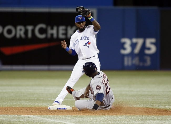 Jul 26, 2013; Toronto, Ontario, CAN; Toronto Blue Jays shortstop Jose Reyes (7) gets out Houston Astros designated hitter Chris Carter (23) in the seventh inning at the Rogers Centre. Mandatory Credit: John E. Sokolowski-USA TODAY Sports