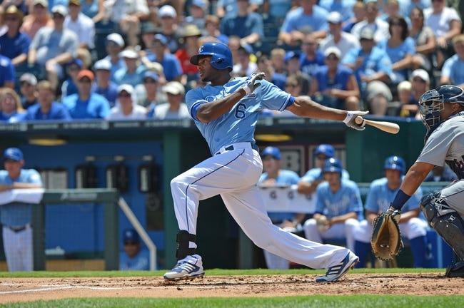 July 21, 2013; Kansas City, MO, USA;  Kansas City Royals left fielder Lorenzo Cain (6) at bat against the Detroit Tigers during the first inning at Kauffman Stadium.  Mandatory Credit: Peter G. Aiken-USA TODAY Sports
