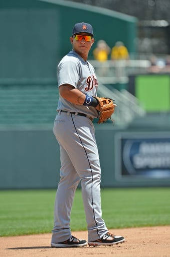 July 21, 2013; Kansas City, MO, USA; Detroit Tigers Third basemen Miguel Cabrera (24) looks to the dugout against the Kansas City Royals during the second inning at Kauffman Stadium.  Mandatory Credit: Peter G. Aiken-USA TODAY Sports