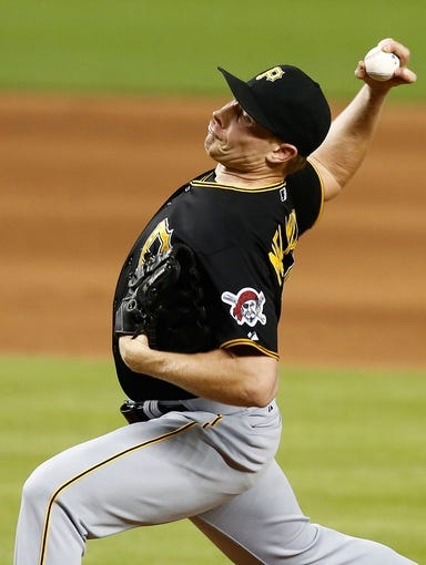Jul 27, 2013; Miami, FL, USA; Pittsburgh Pirates relief pitcher Mark Melancon (35) pitches in the ninth inning against the Miami Marlins at Marlins Park. The Pirates won 7-4.  Mandatory Credit: Robert Mayer-USA TODAY Sports