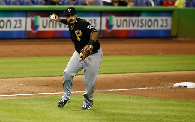 Jul 27, 2013; Miami, FL, USA; Pittsburgh Pirates third baseman Pedro Alvarez (24) throws late to first base on an infield hit by Miami Marlins right fielder Giancarlo Stanton (not pictured) at Marlins Park. The Pirates won 7-4. Mandatory Credit: Robert Mayer-USA TODAY Sports