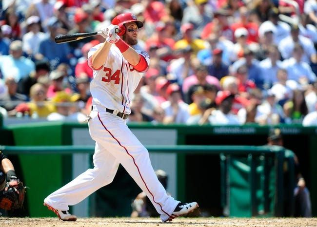 Jul 25, 2013; Washington, DC, USA; Washington Nationals left fielder Bryce Harper (34) hits a double during the sixth inning against the Pittsburgh Pirates at Nationals Park. Mandatory Credit: Brad Mills-USA TODAY Sports