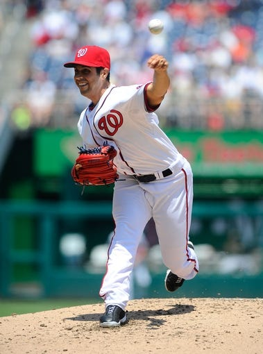 Jul 25, 2013; Washington, DC, USA; Washington Nationals starting pitcher Gio Gonzalez (47) throws during the second inning against the Pittsburgh Pirates at Nationals Park. Mandatory Credit: Brad Mills-USA TODAY Sports