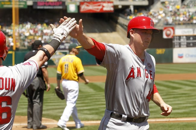 Jul 28, 2013; Oakland, CA, USA; Los Angeles Angels infielder Mark Trumbo (44) is congratulated by outfielder Kole Calhoun (56) after scoring a run against the Oakland Athletics in the first inning at O.co Coliseum. Mandatory Credit: Cary Edmondson-USA TODAY Sports