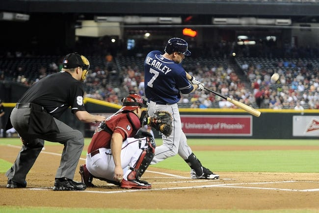 Jul 28, 2013; Phoenix, AZ, USA; San Diego Padres infielder Chase Headley (7) triples to center against the Arizona Diamondbacks in the first inning at Chase Field. Mandatory Credit: Jennifer Stewart-USA TODAY Sports