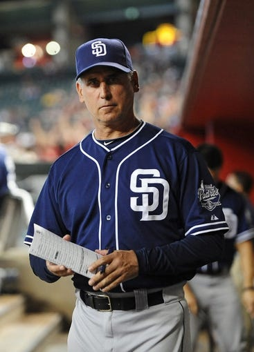 Jul 28, 2013; Phoenix, AZ, USA; San Diego Padres manager Bud Black makes changes to the lineup in the game against the Arizona Diamondbacks at Chase Field. The Padres defeated the Diamondbacks 1-0. Mandatory Credit: Jennifer Stewart-USA TODAY Sports