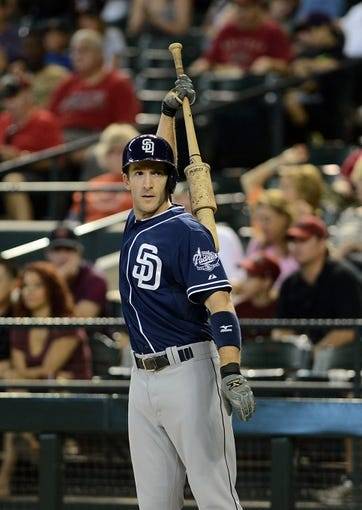 Jul 28, 2013; Phoenix, AZ, USA; San Diego Padres outfielder Chris Denorfia (13) warms up in the on deck circle against the Arizona Diamondbacks in the second inning at Chase Field. The Padres defeated the Diamondbacks 1-0. Mandatory Credit: Jennifer Stewart-USA TODAY Sports