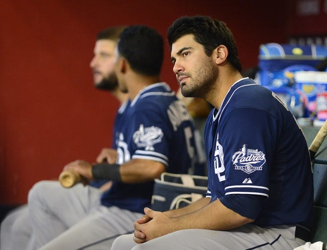 Jul 28, 2013; Phoenix, AZ, USA; San Diego Padres outfielder Carlos Quentin (18) watches from the dugout in the game against the Arizona Diamondbacks at Chase Field. The Padres defeated the Diamondbacks 1-0. Mandatory Credit: Jennifer Stewart-USA TODAY Sports